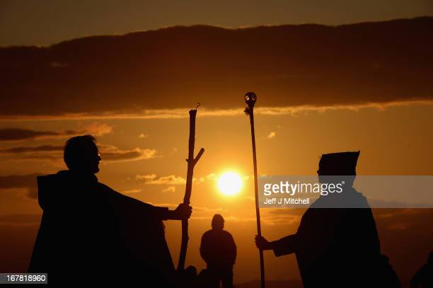 Members of the public wait to watch performers celebrate the coming of summer by during the Beltane Fire Festival on Calton Hill April 30 2013 in...