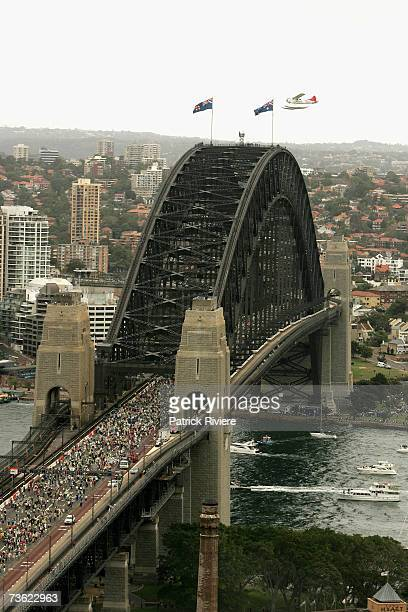 Members of the public walk across the Sydney Harbour Bridge as seen from the ShangriLa hotel during the 75th anniversary celebrations of the opening...