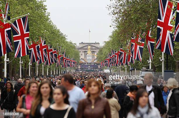 Members of the public walk along The Mall which is closed to traffic and bedecked with Union Flags for the Diamond Jubilee weekend on June 2 2012 in...