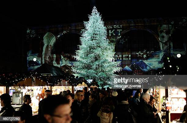 Members of the public walk by a huge christmas tree sponsored by Swarovski Jewelry inside the Zurich main train station on December 20 2014 in Zurich...