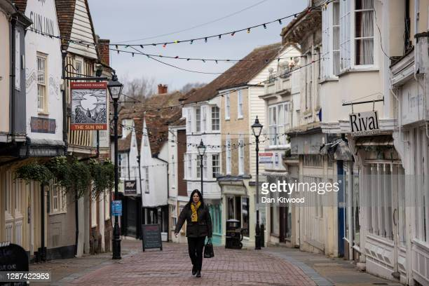 Members of the public walk down the high street on November 24, 2020 in Faversham, Kent. The Swale Valley borough in Kent, currently has the highest...