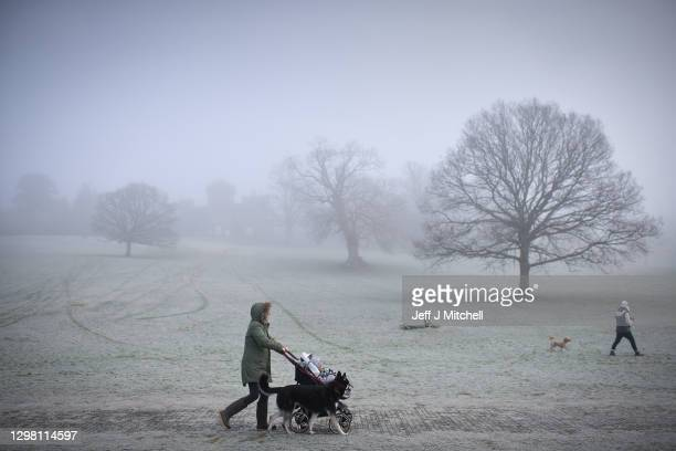 Members of the public walk in a misty Balloch Country Park on January 24, 2021 in Balloch,Scotland. Parts of the country saw snow and icy conditions...