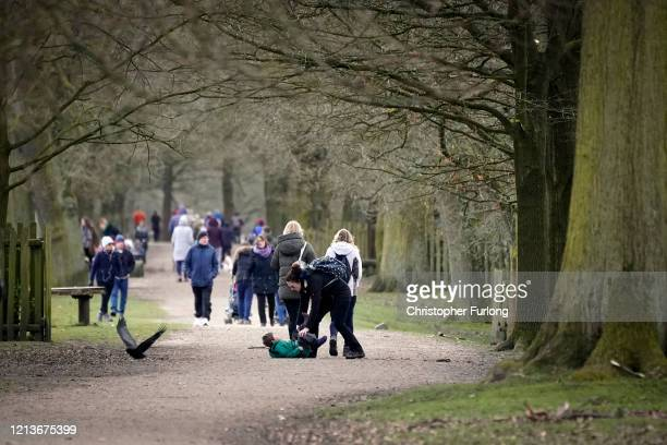 Members of the public walk in the grounds of the National Trust's Dunham Massey Park on March 20 2020 in Altrincham United Kingdom The National Trust...