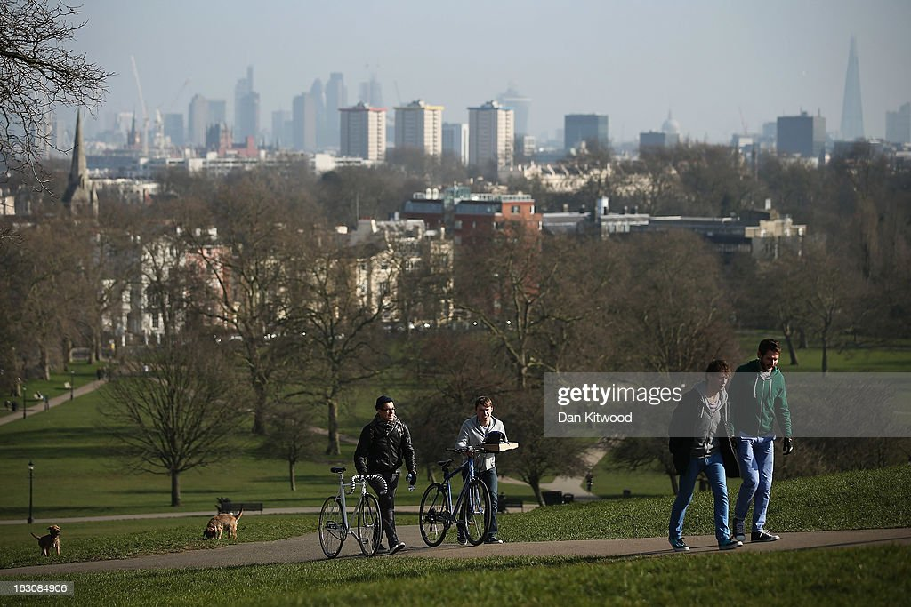 Members of the public walk in the sunshine on Primrose Hill on March 4, 2013 in London, England. The Met office has predicted the warmest day of the year tomorrow with a top temperature of 15 degrees in some parts of the country.