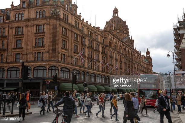 Members of the public walk near the department store Harrods, near the home of Zamira Hajiyeva, the wife of Azerbaijan state banker Jahangir Hajiyev,...