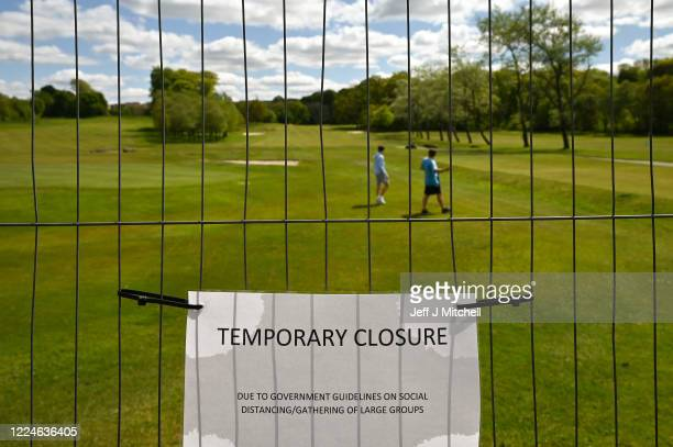 Members of the public walk on Elderslie golf course on May 13 2020 in Glasgow United Kingdom The prime minister announced the general contours of a...