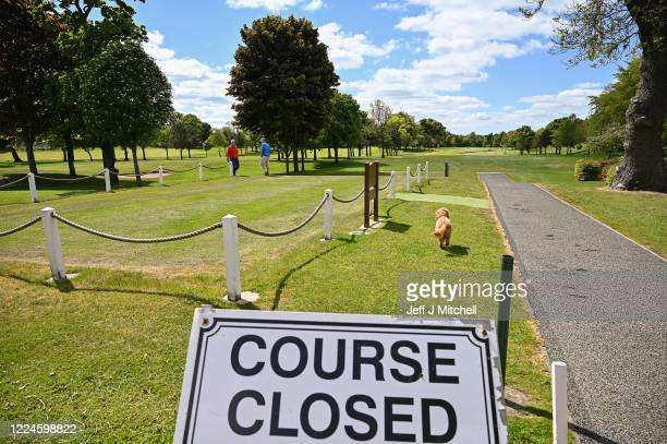 Members of the public walk on Haggs Castle golf course on May 13 in Glasgow United Kingdom. The prime minister announced the general contours of a...