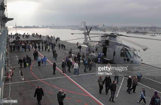 Members of the public walk on the flight deck of the HMS Ark Royal on January 22 2011 in Portsmouth England Thousands of people are expected to visit...