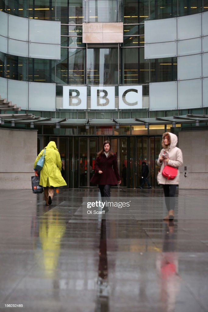 Members of the public walk outside the BBC headquarters at New Broadcasting House on November 12, 2012 in London, England. Tim Davie has been appointed the acting Director General of the BBC following the resignation of George Entwistle after the broadcasting of an episode of the current affairs programme 'Newsnight' on child abuse allegations which contained errors.