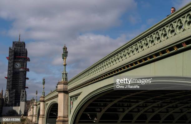 Members of the public walk over Westminster Bridge on the first anniversary of the Westminster Bridge terror attack on March 22 2018 in London...
