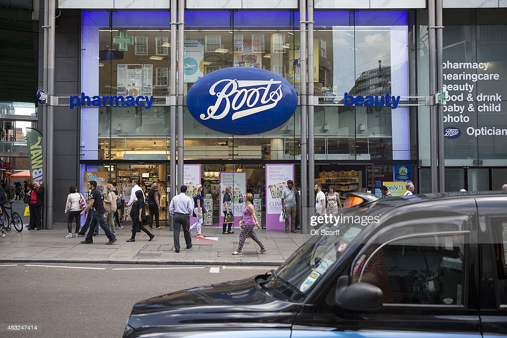 Members of the public walk past a branch of Boots the chemist on Oxford Street on August 6, 2014 in London, England. US pharmacy chain 'Walgreens', who previously owned 45% of 'Alliance Boots' has announced a 9 billion GBP purchase of the remaining shares in the company. Boots currently have 2,487 stores across the UK and employ over 60,000 people.
