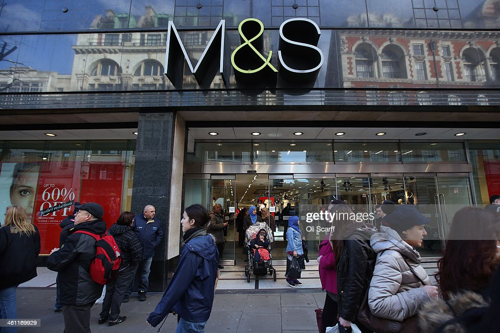 Members of the public walk past a branch of Marks & Spencer on January 7, 2014 in London, England. The food and clothing retailer, which has traded for 130 years, has seen a recent drop in share price as investors are predicting disappointing sales figures for the store's clothing division.