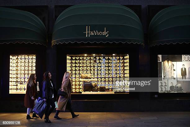 Members of the public walk past Harrods department store on January 4 2017 in London England The union that represents the catering staff at Harrods'...