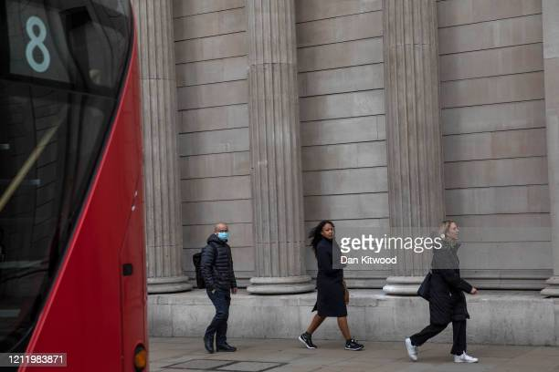 Members of the public walk past The Bank of England on March 12 2020 in London England The FTSE 100 Index fell 5054 per cent when trading opened in...