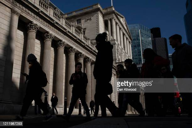 Members of the public walk past The Bank of England on March 12, 2020 in London, England. The FTSE 100 Index fell 5054 per cent when trading opened...