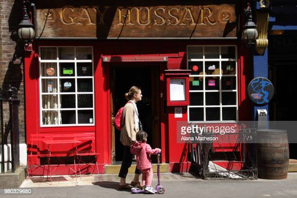 Members of the public walk past the Hungarian restaurant 'Gay Hussar' in Soho on June 21 2018 in London England The restaurant is due to close its...