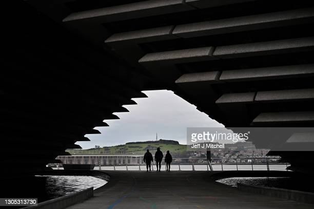 Members of the public walk past The V&A Dundee on March 04, 2021 in Dundee, Scotland. The UK Chancellor, Rishi Sunak, announced sites of England's...