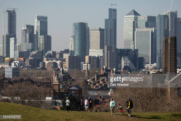 Members of the public walk through Greenwich Park on March 25 2020 in London England British Prime Minister Boris Johnson announced strict lockdown...