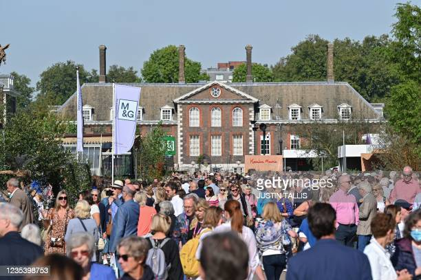 Members of the public walk through the 2021 RHS Chelsea Flower Show in London on September 21, 2021.