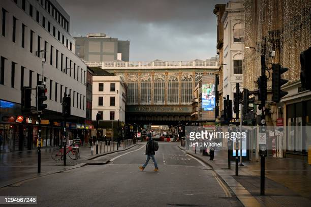 Members of the public walk through the city centre as new Covid–19 rules come into place on January 5, 2021 in Glasgow, Scotland. New lockdown...