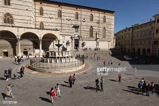 Members of the public walk through the Palazzo dei Priori in the city of Perugia, the capital of the central Italian region of Umbria, on October 01,...