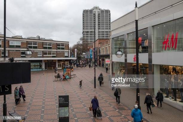 Members of the public walk through the town centre on February 20 2019 in Swindon England The car manufacturer Honda announced on Tuesday it is to...