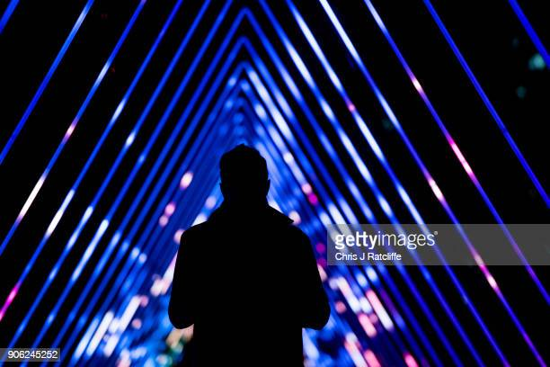 Members of the public walk through 'The Wave' by Vertigo at Riverside Walkway South Bank during Lumiere London festival of light 2018 on January 17...