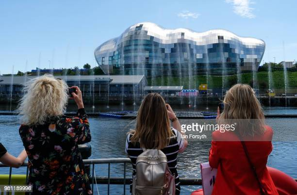 Members of the public watch as a water fountain art installation displays in the middle of the River Tyne at the launch of the Great Exhibition of...