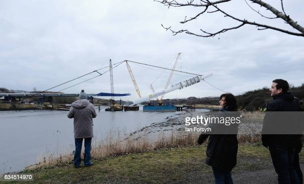 Members of the public watch as the final 100 metre centrepiece of Sunderland's new River Wear crossing is lifted into place on February 10 2017 in...