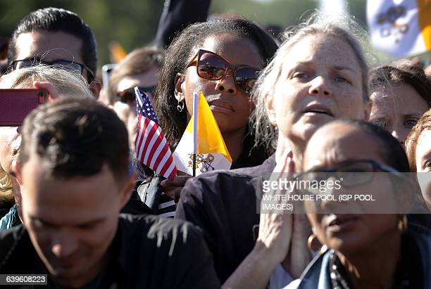 Members of the public watch the arrival ceremony for Pope Francis on the South Lawn of the White House on September 23 2015 in Washington DC The Pope...
