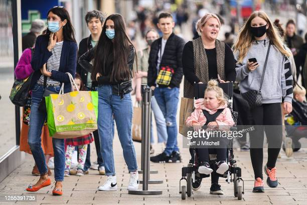 Members of the public wear face covering as they shop on Princess Street on July 10, 2020 in Edinburgh, Scotland. Wearing a face covering is now...