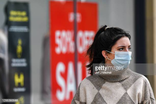 Members of the public wear face covering as they shop on Princess Street on July 10 2020 in Edinburgh Scotland Wearing a face covering is now...