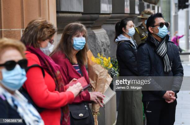 Members of the public wear face masks as they attend a service at The Cenotaph in Martin Place to commemorate the 75th anniversary of the Victory in...