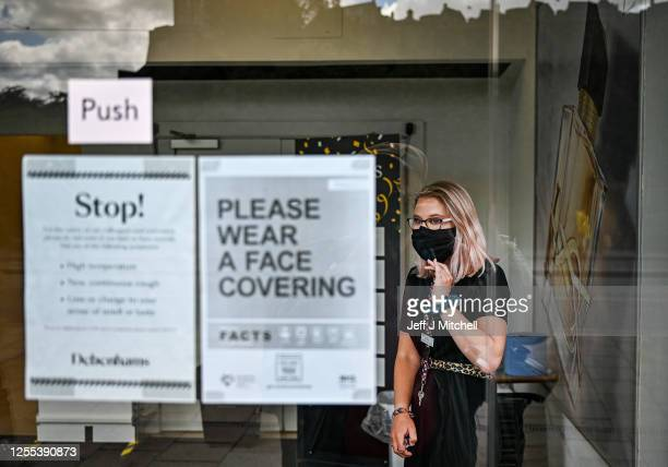 Members of the public wear face masks as they shop on Princess Street on July 10 2020 in Edinburgh Scotland Wearing a face masks is now mandatory in...