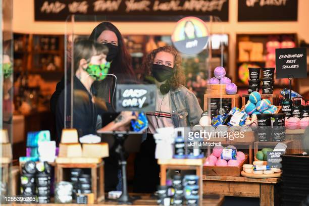 Members of the public wear face masks as they shop on Princess Street on July 10, 2020 in Edinburgh, Scotland. Wearing a face masks is now mandatory...