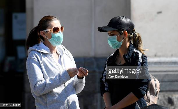 Members of the public wear protective masks on April 26 2020 in LondonEngland The British government has extended the lockdown restrictions first...