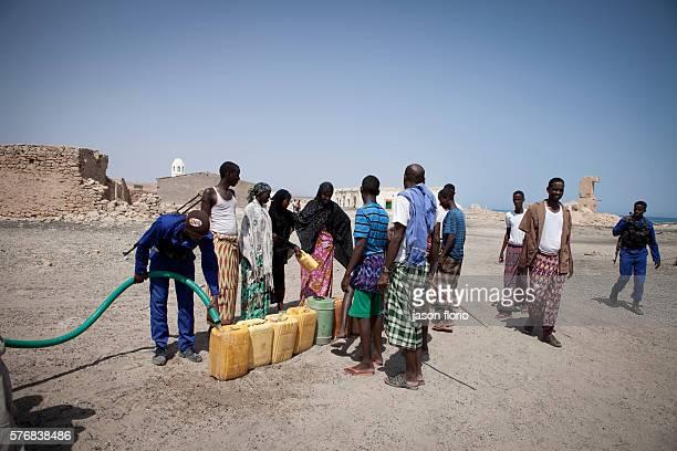 Members of the Puntland Maritime Police Force distirbuting water near Bosaso Somalia The Puntland Maritime Police Force is a locally recruited...