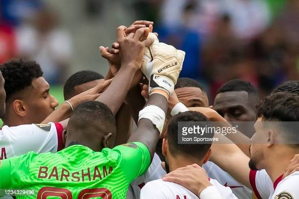 Members of the Qatar national team prepare to break huddle during the Gold Cup semifinal match between the United States and Qatar on Thursday July...