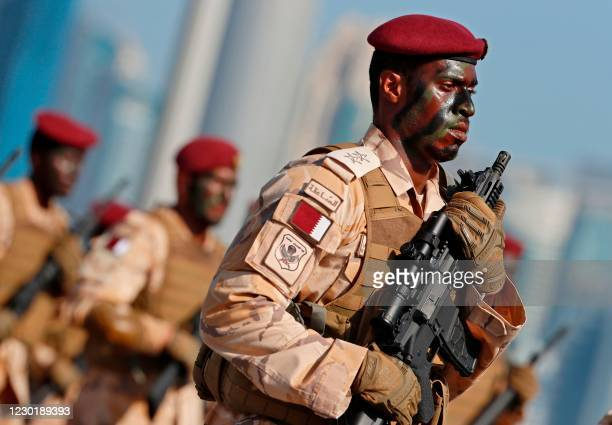 Members of the Qatari armed forces take part in a military parade to mark their country's national day celebration, in the capital Doha on December...