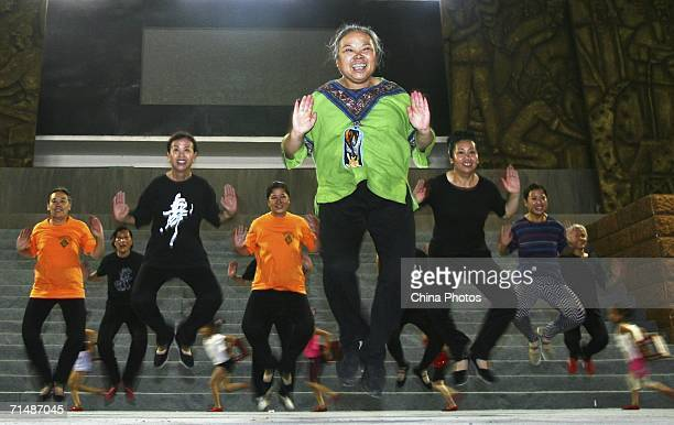 Members of the 'Qiaoxiyang' Senior Citizen Dancing Group participate in a rehearsal of their performance at Tangshan Gymnasium on July 18 2006 in...