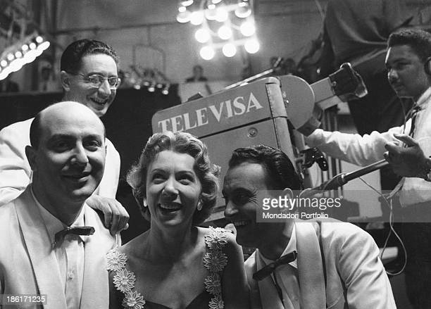 Members of the Quartetto Cetra smiling in front of a Televisa camera The band is formed by Italian singer and drummer Felice Chiusano Italian singer...