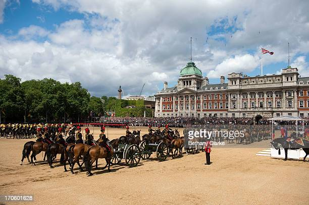 Members of the Queen's Guard and the Household Cavalry march during the Trooping Of The Colour at Horse Guards Parade on June 15 2013 in London...
