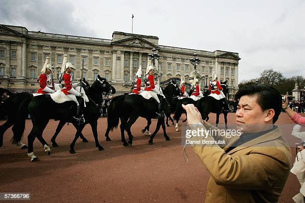 Members of the Queens Guards Household Cavalry ride past Buckingham Palace on April 19,2006 in London, England. TRH Queen Elizabeth II and Prince...