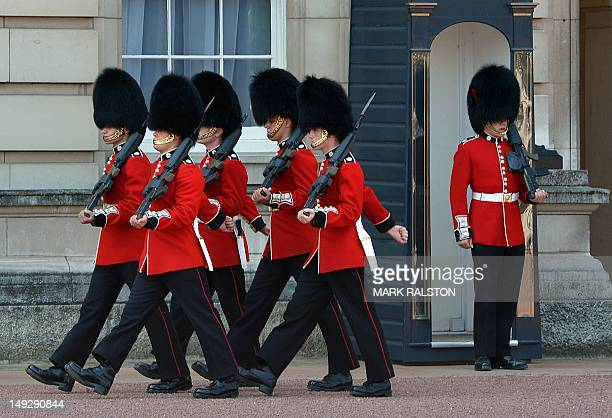 Members of the Queen's Guards march outside Buckingham Palace in central London on July 26 2012 British Prime Minister David Cameron declared...