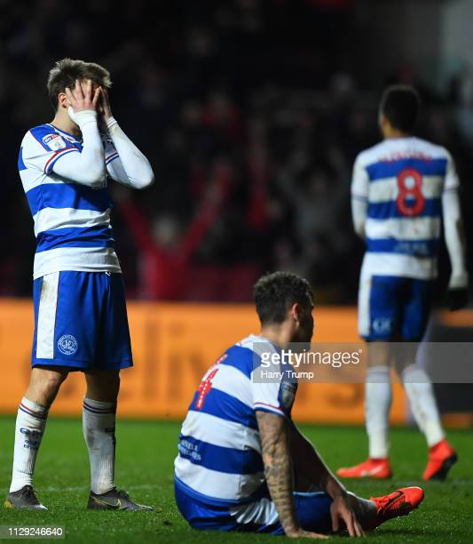 Members of the Queens Park Rangers side cut dejected figures after conceding a penalty during the Sky Bet Championship match between Bristol City and...