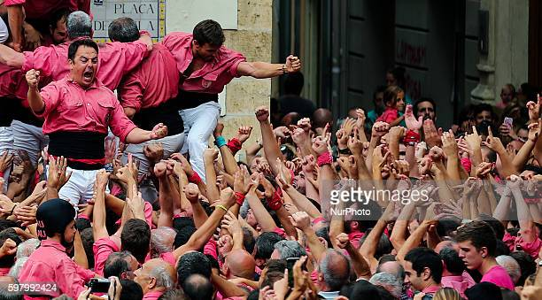 Members of the quotCastellers de Villafrancaquot Human Tower team celebrate after forming a quotcastellquot during an exhibition of the human towers...