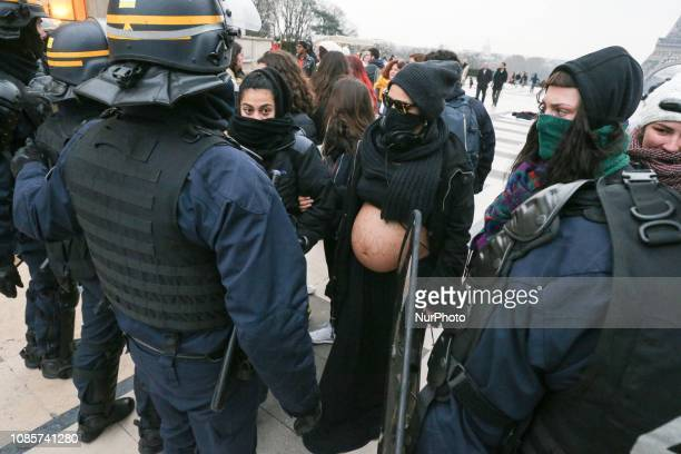 Members of the quotWitch Blocquot feminist group demonstrate behind riot police as they came to disturb the prolife movement 13th quotMarch for...