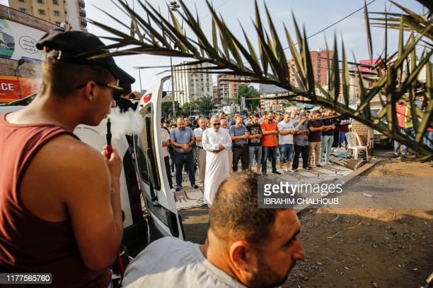Members of the radical Islamist movement Hizb utTahrir pray together during a demonstration on the sixth day of protest against tax increases and...