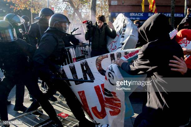 Members of the radical left summoned by the Catalan separatists CDR clash with the police in Barcelona for hours in response to the meeting of the...