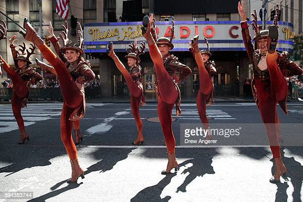 Members of the 'Radio City Rockettes' perform during their annual 'Christmas in August' event outside of Radio City Music Hall on 6th Avenue August...